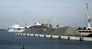 Ships and cranes in the harbour. Ships in the harbour, port Klaipeda Royalty Free Stock Images