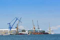 Ships and cranes Warnemunde port Royalty Free Stock Photos