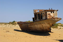 The ships in desert, Aral Sea disaster, Muynak, Uzbekistan. Destruction of the ships - The picture is made in Kara-Kalpak Uzbekistan in the dead city of Mujnak Stock Image