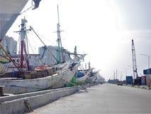 Ships docked in harbor. Wooden cargo ships docked in harbor Stock Images