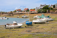 Ships by ebb-tide in harbor of  Brittany Royalty Free Stock Image