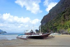 Ships Filipino fishermen near the shore. Royalty Free Stock Image