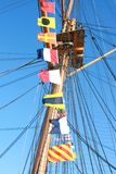 Ships Flags. With rigging on HMS Warrior, Hampshire, Portsmouth UK. Flags spell out the word BIRTHDAY from top to bottom Stock Photography