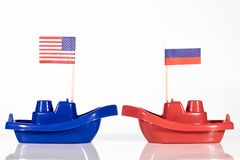 Ships with the flags of united states and russia or russian fede. Ration in front of white background stock photo