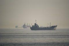 Ships in the fog stock photos