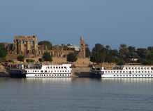Ships in front of Kom Ombo stock photo