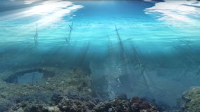 Ships graveyard underwater under the ocean with light rays stock video footage