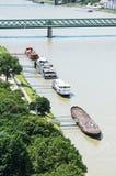 Ships, greenery and bridge over the Danube river in Bratislava c Royalty Free Stock Image