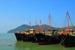 Ships in the harbor. Beautiful photo of colorful harbor with row of the ships and mountains in the background, photo taken in Lantau Island in Hong Kong Stock Images