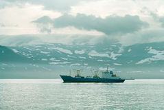 Ships in the harbor of island Paramushir, Russia Royalty Free Stock Photography