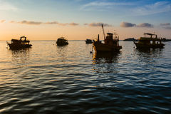 Ships in the harbor. Transport ships at dawn. Ships in the harbor Royalty Free Stock Photography