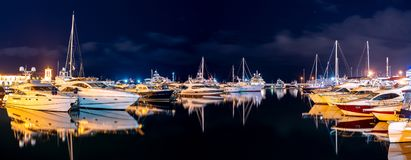 Ships in the harbor under the night starry sky. Black Sea, Sochi, Europe stock photos