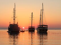 Free Ships In A Mediterranean Sea . Calm Sunrise Royalty Free Stock Photography - 194639487