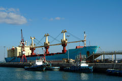 Ships at industrial dock. Ships tied to a commercial, industrial dock Royalty Free Stock Photography