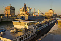Ships in a lock at sunset Royalty Free Stock Photography