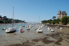 Ships on low tide dry harbour bed in Bretagne France Stock Image