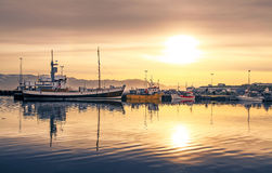 Ships lying in the harbor of Husavik at sunset, Iceland Royalty Free Stock Photo
