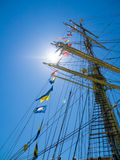 Ships mast, flags and sunburst. Stock Images