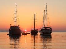 Ships in a Mediterranean sea . Calm sunrise