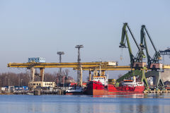 Ships moored in the harbor and a big cranes stock images