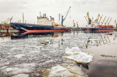 The ships moored at the Sea port and the ice drift on the Sea canal. Saint Petersburg, Russia, March 26, 2016. The ships moored at the Sea port and the ice Royalty Free Stock Image