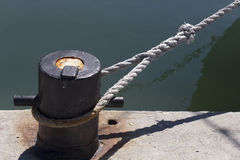 Ships mooring bollard with heavy duty mooring ropes Stock Photo
