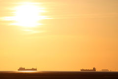 Ships in Morecambe Bay, England at sunset. Royalty Free Stock Images