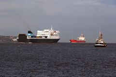 Ships at mouth of port. Scenic view of ferry, tanker and tug boat at mouth of Mersey River, Liverpool, England stock photo