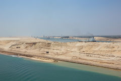 Ships navigating in convoy through the New Suez Canal. Editorial: ISMAILIA, EGYPT, April 27, 2017 - Ships navigating in convoy through the New Suez Canal near Royalty Free Stock Photo