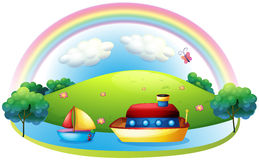 Ships near an island with a rainbow Royalty Free Stock Photos