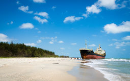 Ships ORAPIN 4 hit by Waves crashing ashore. Royalty Free Stock Photo