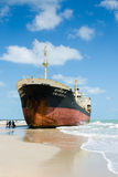 Ships ORAPIN 4 hit by Waves crashing ashore. Royalty Free Stock Images