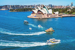 Ships passings the Opera House Royalty Free Stock Photo