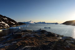 Ships on pier in Ilulissat icefjord of the Greenland.  May 2016 Royalty Free Stock Image