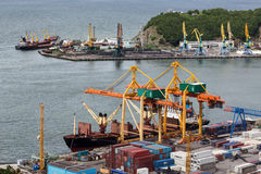 Ships at the pier, port cranes on seaport Petropavlovsk-Kamchatsky. Russia, Kamchatka, Avacha Bay Stock Photos