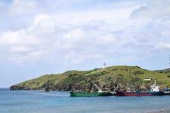 Ships at port of Basco at Batan island in Batanes, Philippines - Series 2 Stock Photo