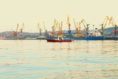 Ships in the port of Feodosia. Tug boat put out from the Port of Feodosia, Crimea stock photography