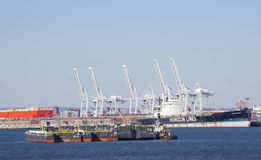 Ships in port. Heavy cargo ships in the port of a big city Stock Photos