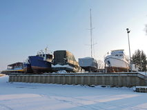 Ships on river coast in winter Stock Photos