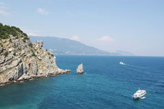 Ships rocks on blue sea. Two white ships on blue sea surface view from the top Royalty Free Stock Images