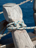 Ships rope tied off on a bollard Royalty Free Stock Image