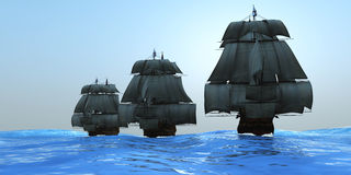 Ships in Sail. Three tall ships in full sail cross a large ocean with glistening blue waters Royalty Free Stock Photos
