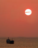 Ships sailing in the sunset Stock Images
