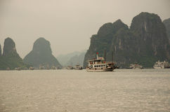 Ships with scenic cliffs in Ha Long Bay, Vietnam stock images