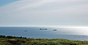 Ships in sea. Three ships in sea of Okhotsk stock images