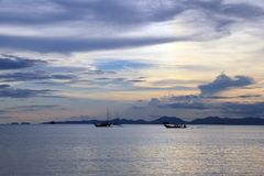 The ships at sea during a sunset. Krabi, Thailand Royalty Free Stock Photos