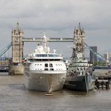 Ships in the shadow of Tower Bridge London UK Stock Photography