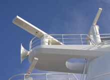 Ships Sonar and Airhorn. A cruise ship tower with sonar and airhorn against blue sky Royalty Free Stock Images