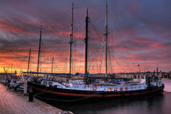Ships at sunset. Ships at night with a beautiful sunset royalty free stock photos