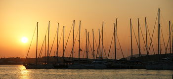Ships at sunset. Murter, Croatia - sailboats anchored for the night Stock Photography